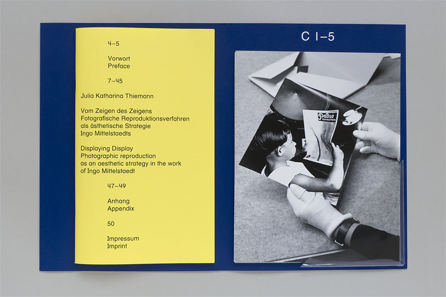 inner design of folder with brochure and photo cards